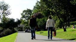 people relax in the park (sitting and walking)- nature (grass and trees) - pavem Footage