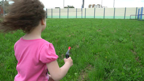 A Little Girl Starts A Paper Airplane And Shoots A Toy Gun 1
