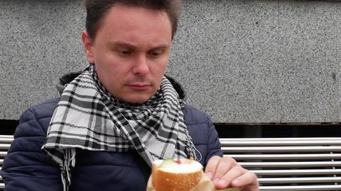 Man eating sandwich Footage