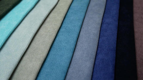 Fabric Samples Of Different Colors In Move Are Spinning And Rotation Footage