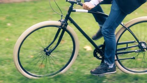 Unrecognizable man riding his retro bike in autumn park Footage