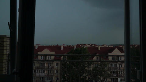 Sloping roofs of town houses in the thunderstorm and lightning Footage