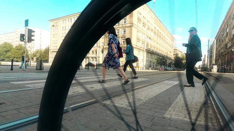 WARSAW, POLAND - JULY 18, 2017. City crosswalk and spinning bike wheel close-up Footage