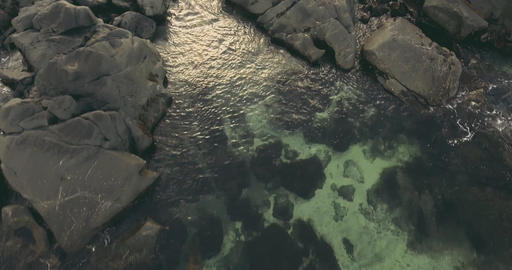 Aerial view of rocks and coastline Live Action