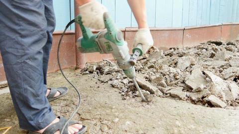 Jackhammer breaks rocks into dust Footage
