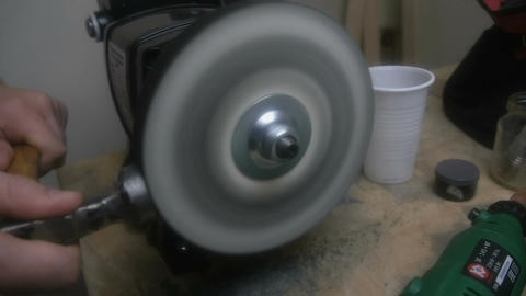 Man sharpens the tool with a grinding disk Footage