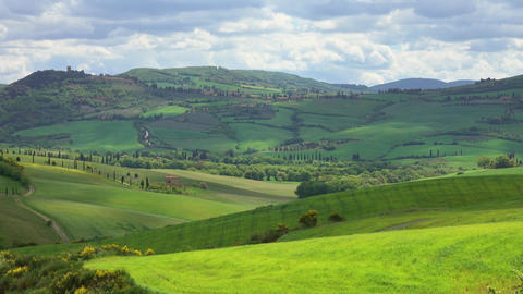 Shadows of clouds slide on the hills of Tuscany Footage