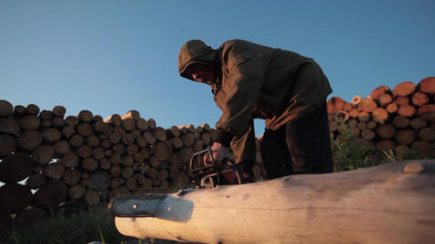 Sawing a log Footage