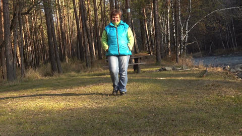 Woman walking in the forest Footage