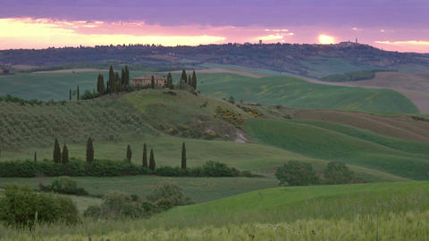 Tuscany at sunrise with farm house and hills Footage