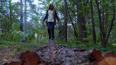Girl walks on a timber Footage
