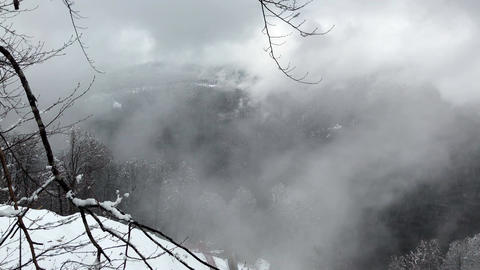 Snowfall and fog in the mountains Footage