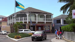 Bahamas Nassau colonial style building and national flag Footage
