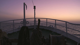 Fishing vessel sailing at sunset Footage