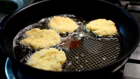 Frying potato pancakes Live Action
