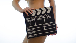 Nude girl with Movie Clap Board Footage