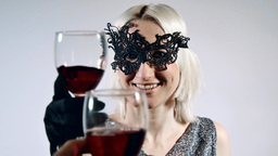 Clinking glasses of red wine celebrating Footage