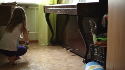 The girl helps parents to do housework Footage