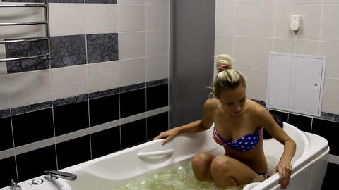 Beautiful girl in the bathtube with bubbles Footage