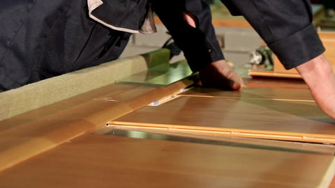 Manual assembly of a wooden door at the woodworking and furniture plant Footage
