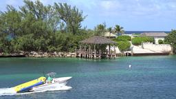 Bahamas Nassau motorboat comes along of small part of Paradise Island Footage