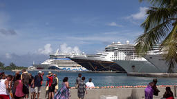 Bahamas Nassau cruise ships bows in row seen from Woodes Rodgers Walk promenade Footage
