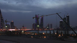 Construction Site in Manama Timelapse at Dusk City Skyline on the background Footage