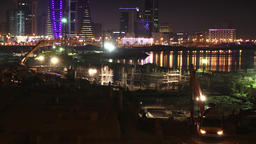 Construction Site in Manama Timelapse at Dusk City Skyline on the background Filmmaterial