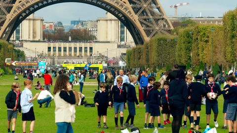 PARIS, FRANCE - OCTOBER 7, 2017. French schoolboys on Champ de Mars lawn near Footage