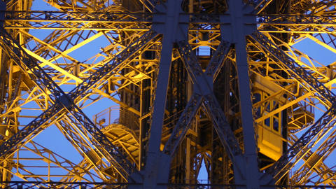 Moving elevators of the Eiffel tower in Paris, France. Telephoto lens shot Footage