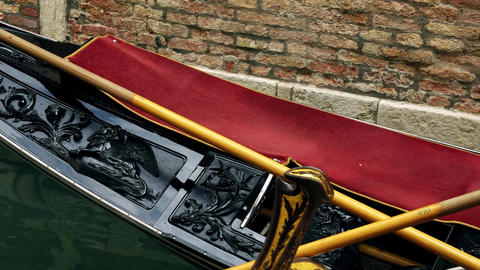 Gondola sliding on the water surface of the Venetian canal in Venice, Veneto Live Action