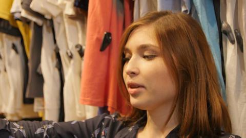 Beautiful Joyful Young Lady Chooses Fashionable Blouses Footage