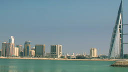 Pan from City Skyline to World Trade Center Bahrain Wide Angle ビデオ