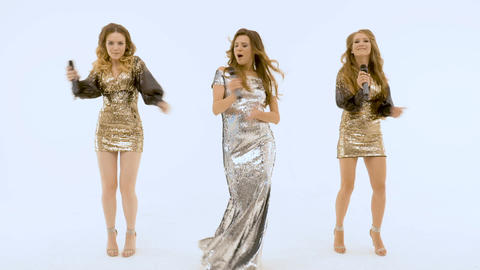 Three girls singer clapping in the rhythm of music. slow motion Live Action