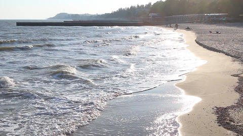 The reflection of the evening sun in the waves Footage