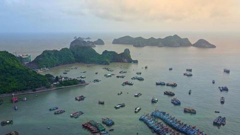 Camera Moves over Quiet Ocean Bay against Rocky Islands Footage