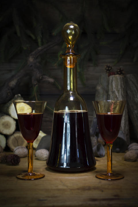 Red Wine Vintage Bottle and Glasses Resting On Wooden Table Against Christmas Fotografía