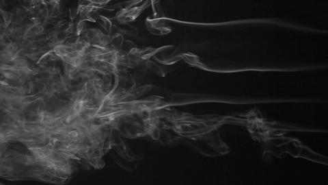 Five stream of white smoke turning into smoke puffs on a black background Footage