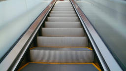 escalators are shown that constantly run upstairs Filmmaterial
