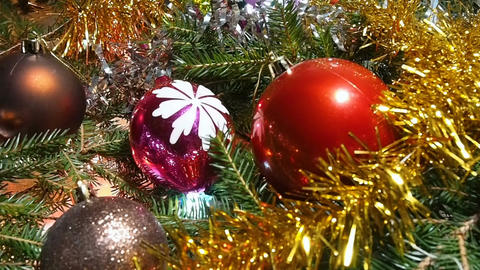 Christmas decorations lying among the branches Footage