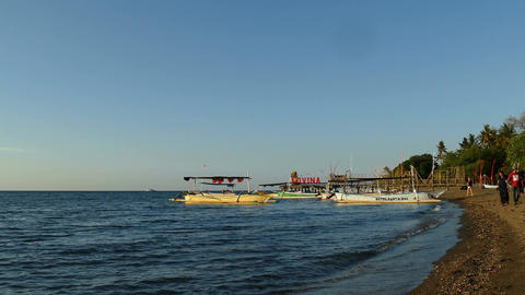 Lovina beach with sign at sunset, Bali, Indonesia Live Action