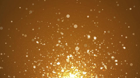 Shining Flying Glittering gold sparkles Glittering in a gold background Animation