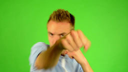 man - green screen - portrait - man boxing (in shirt) Footage