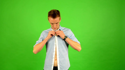 man - green screen - portrait - man unbuttoned his shirt and man buttoning his s Footage