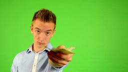man - green screen - portrait - man offers money (czech crown) Footage