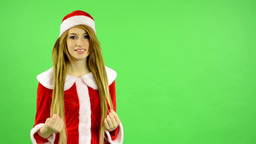 Christmas - Holidays - young attractive woman - green screen - woman adjusts her Footage