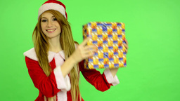 Christmas - Holidays - young attractive woman - green screen - woman with gift Footage