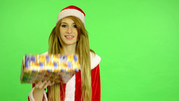 Christmas - Holidays - young attractive woman - green screen - Woman offers a gi Footage