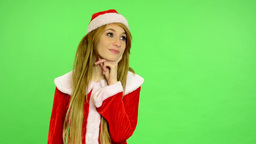 Christmas - Holidays - young attractive woman - green screen - woman thinking Footage
