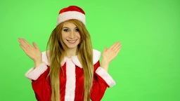 Christmas - Holidays - young attractive woman - green screen - woman is surprise Footage